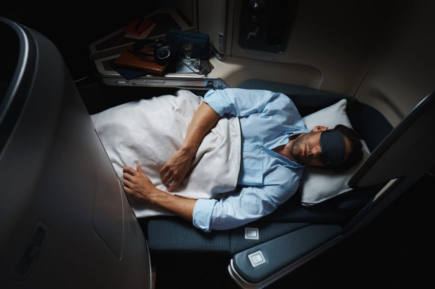 A business class seat in lie-flat mode on the Cathay Pacific Airbus A350.
