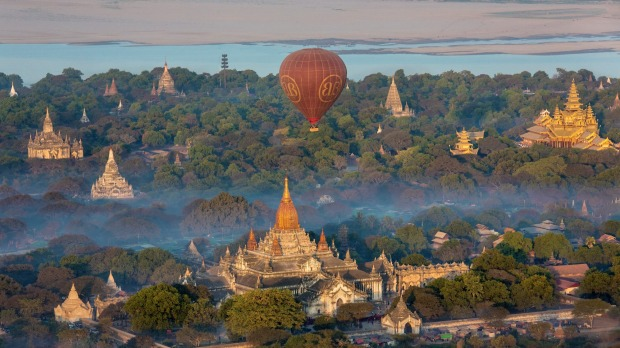 Bagan, Myanmar. Climbing the religious pagodas is a major draw to the famous temple landscape, which is expected to be ...