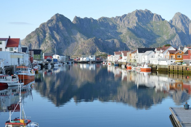 Late afternoon photo of Hennigsvaer - a beautiful town on the Flotan Islands in Norway's arctic circle.  The clarity of ...