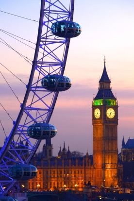 The London Eye and Houses of Parliament at dusk.