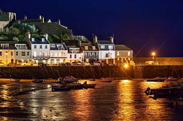 Mont Orgueil Castle and Gorey harbour at night, Jersey, Channel islands, UK.