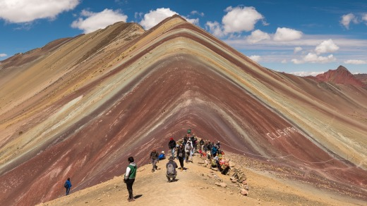 Vinicunca Mountain (Rainbow Mountain) Peruvian Andes. The climb to get here is a challenge but well worth it to stand ...