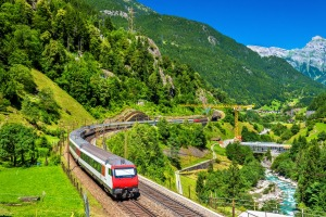 An Intercity train on the old Gotthard railway through the spectacular pass in Siwtzerland.