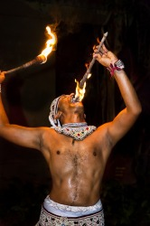 Traditional dancer from Sri Lanka. This is a fire dancer. Its believed to wade off evil spirits.