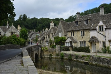Known as the prettiest town in England, Castle Combe is a village parish in Wilshire. This view from Smarts bridge is ...