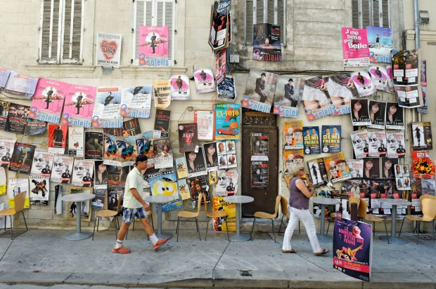 Posters advertising shows during the Avignon Festival,  France.