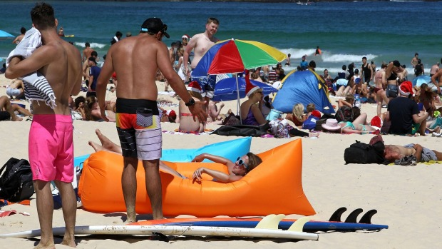 Another country: People celebrate Christmas Day on Bondi Beach.