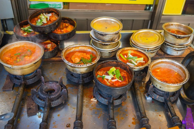 Traditional tasty Korean street food cooking on a roadside grill in downtown Seoul, South Korea's vibrant capital city.