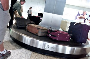 NO CAPTION INFORMATION PROVIDED photo by Phil Carrick baggage luggage carousel airport airline qantas passengers flight ...
