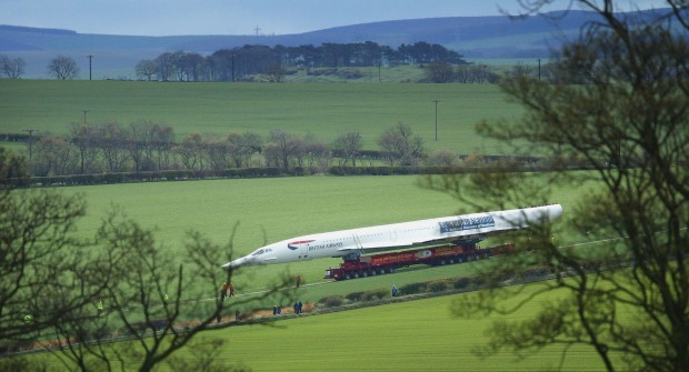 Plane on a train: A Concorde makes its way to its final resting place - Scotland's Museum of Flight.