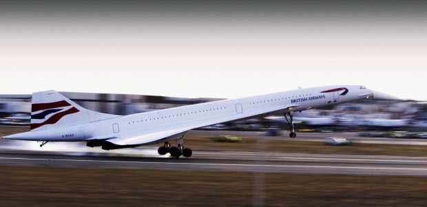 The last ever British Airways commercial Concorde flight touches down at Heathrow airport in London.
