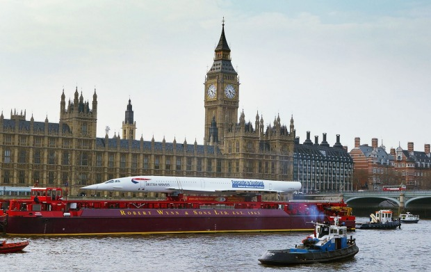 End of an era: The last decommissioned Concorde sails down the River Thames in London in 2004, on its way to the Museum ...