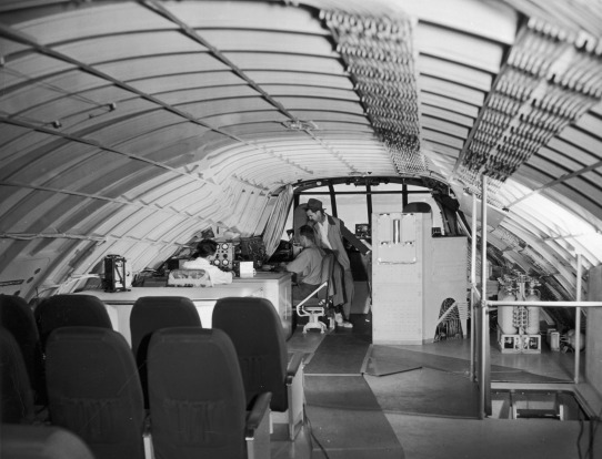 Howard Hughes talks to staff on board the 'Spruce Goose' prior to its first and only flight in 1947.