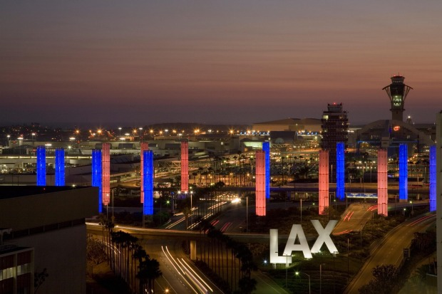 Aerial view of LAX Los Angeles International Airport at sunset.