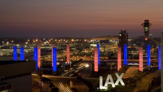 Los Angeles International Airport at sunset with decorative light tubes.