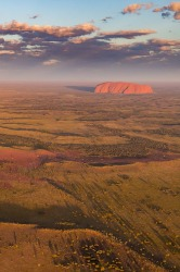 Uluru from the air. The increased rainfall in Central Australia in 2016 has turned the red centre a touch of green!