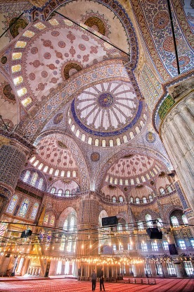 A couple of tourists taking in the size and grandeur of the stunning Blue Mosque, Istanbul.
