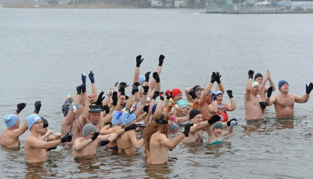 Winter swimming fans welcome the New Year in the icy waters of the Zalew Zegrzynski lake in Nieporet, Poland.