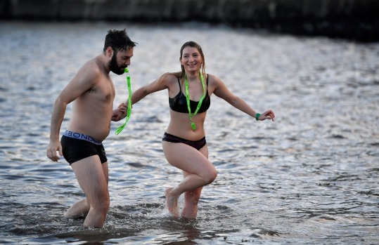 About 1000 swimmers hit the water in front of the Forth Rail Bridge during the annual Loony Dook Swim in the River Forth ...