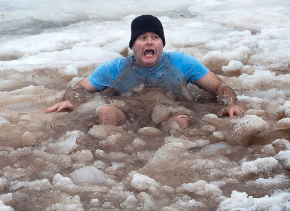 A reveler braves packed ice while participating in the annual New Year's polar bear dip in Charlottetown Harbour on ...