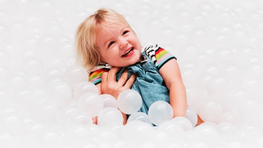 A child plays in the 1.1 million polyethylene balls which make up 'The Beach'.