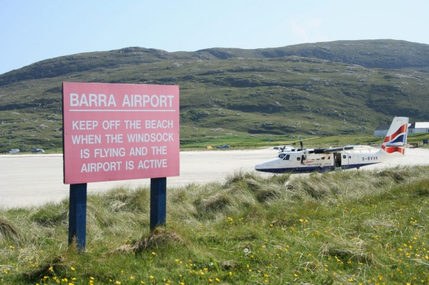 BARRA, SCOTLAND.  On the island of Barra In the Outer Hebrides off the west coast of Scotland, pilots have to wait until ...