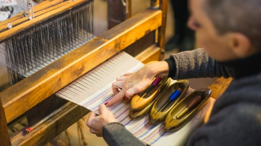 True artisans: Hand weaving in Italy's most celebrated handmade textile and weaving workshop.