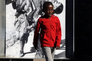 Historic photo at memorial: 13-year-old Hector Pieterson is carried after being shot by police during the 1976 Soweto ...