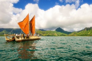 The day breaks over Hokulea with Kualoa behind her.