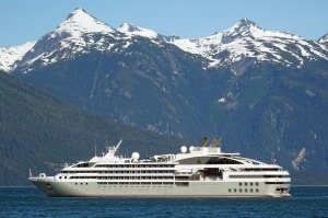 Le Soleal takes passengers past the snow-capped mountains and pine-topped islands of Alaska.
