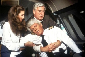 Passengers were lucky Dr. Rumack (Leslie Nielsen, rear) was on board in 1980 comedy film Flying High.