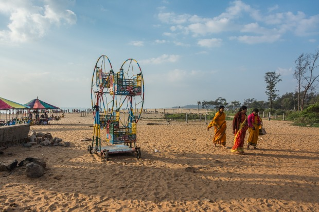 On a beach south of Chennai, India pilgrims gather to greet the rising sun.  There are numerous activities such as horse ...