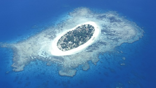 White sand beaches: Aerial view of Fiji's Treasure island.