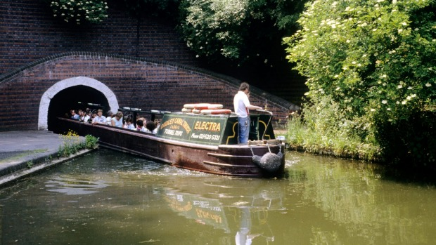 Barges at the Dudley Black Country Museum in England allow visitors to explore rock formations, limestone mines, branch ...