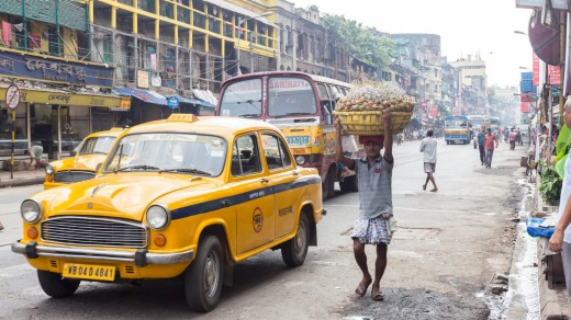 The ubiquitous yellow taxi in a Kolkata street.