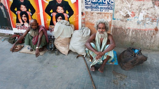 Two homeless men beg for alms in the Chowringhee suburb of Kolkata.