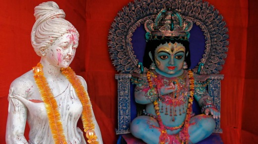 Shiva, as a blue child, and a Grecian-style statue showing the after-effects of Holi, in Kumortuli, the potters' village.