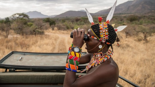 A Sarara Camp lodge guide searches for wildlife.