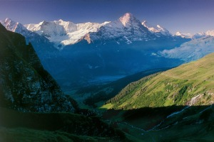 View above Grindelwald towards the Fiescherhoerner and the Eiger in the Bernese Oberland.