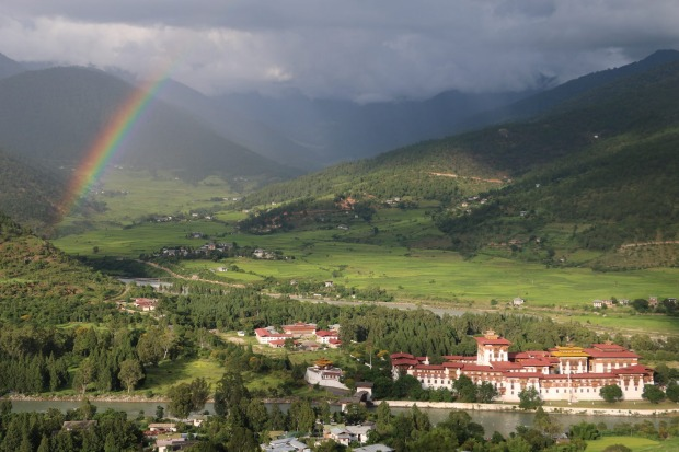 Punakha Dzong: Watching from our room at the Zhingkham Hotel, the afternoon rained rolled in across Punakha Valley, ...