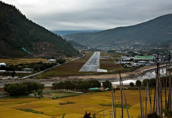PARO, BHUTAN. Bhutan's only international airstrip, Paro Airport sits in a serpentine river valley shadowed by mountains ...