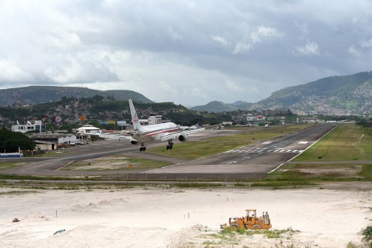 TONCONTIN, HONDURAS. The mountainous terrain dictates a swerving approach to this international airport, which serves ...