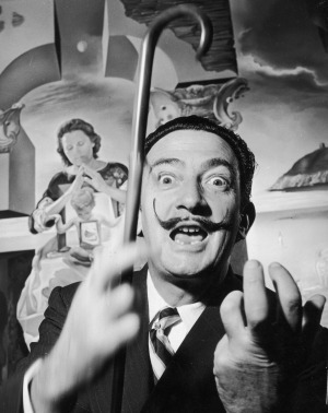 Salvador Dali in London with one of his paintings entitled The Madonna of Port Lligat.