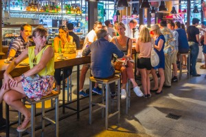 Tourists and locals enjoying drinks and tapas at the Mercado de San Miguel in  Madrid