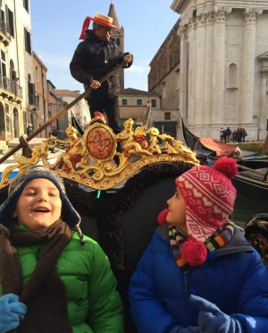 Taking a Gondola ride through Venice.