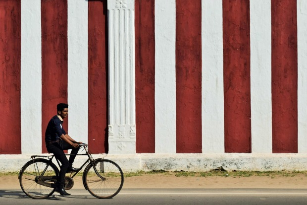 The afternoon commute near Nallur Kandaswamy Kovil in Jaffna, Sri Lanka. This photo was taken during a cross-country ...