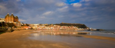 Scarborough, Yorkshire, UK. Jan 2015. Amusement centres, penny slots, Scarborough rock, fishing trawlers and good 'ol ...