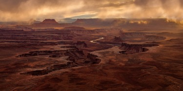 This is shot is taken at Canyonlands National Park in Utah, USA. A storm brought in hanging cloud and eeire light at ...
