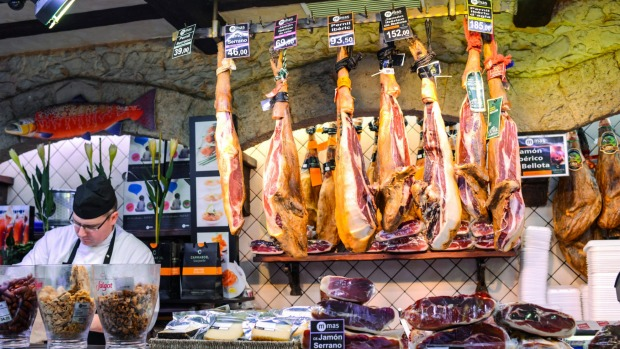 Divine jamon: Serrano and Iberian ham at La Boqueria food market, Barcelona, Spain.