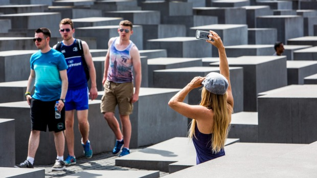 Tourists taking photos at the Holocaust Memorial in Berlin.